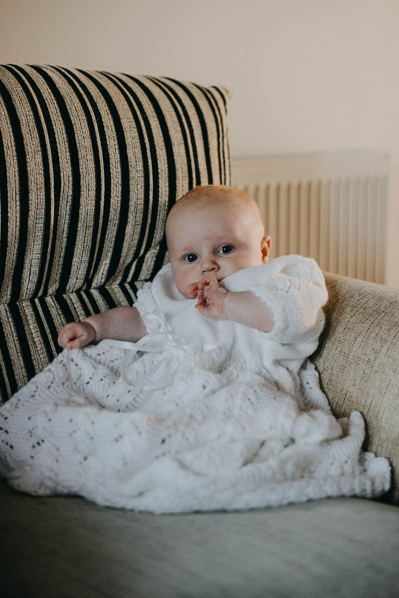baby in christening dress