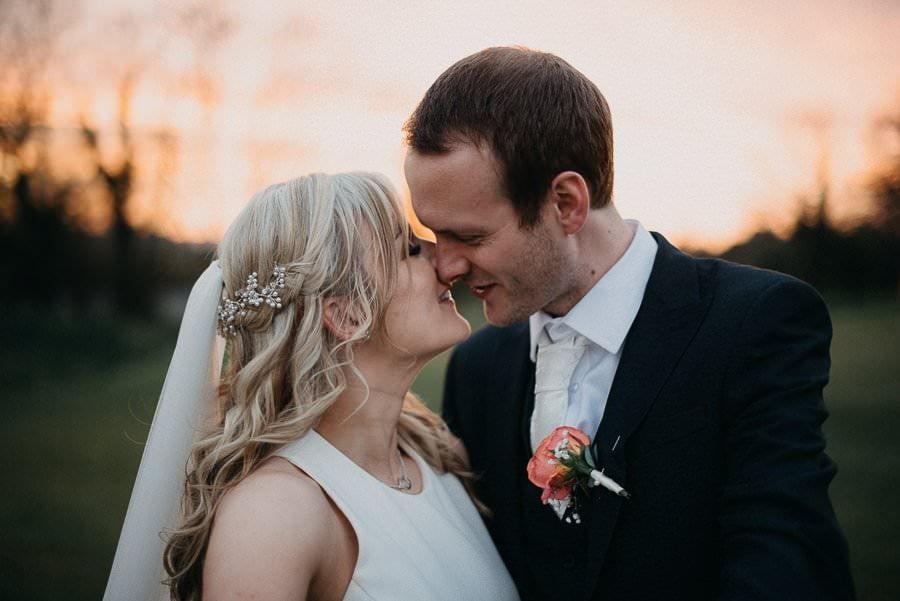 bride and groom kiss in castle dargan wedding venue