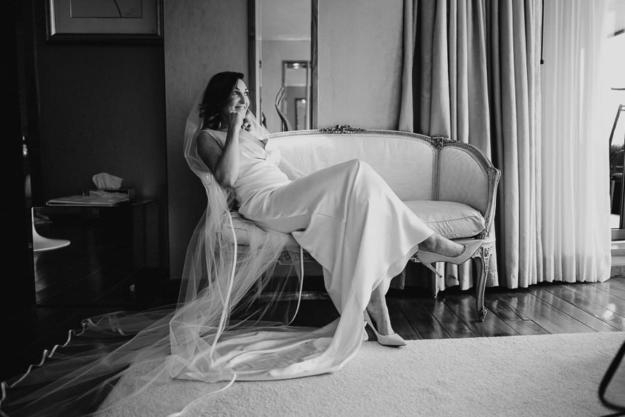 bride in the g hotel room rady for wedding