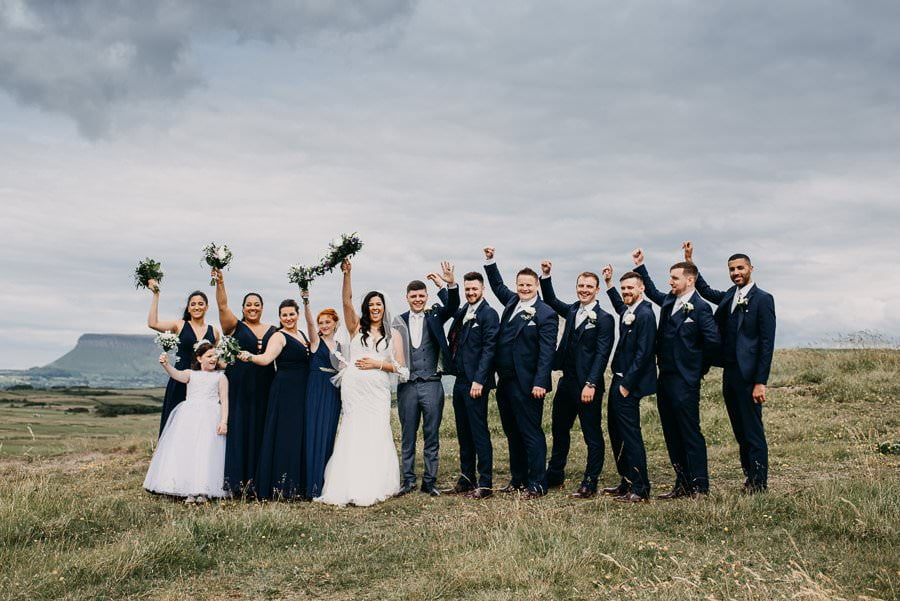 brides and groomsmen at rosses point beach